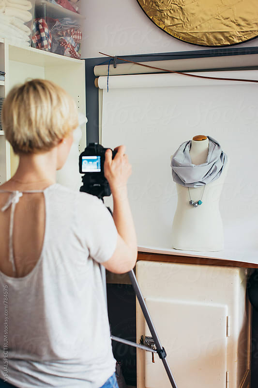 Blond Female Fashion Designer Photographing Scarf on Display Dummy by Julien L. Balmer for Stocksy United