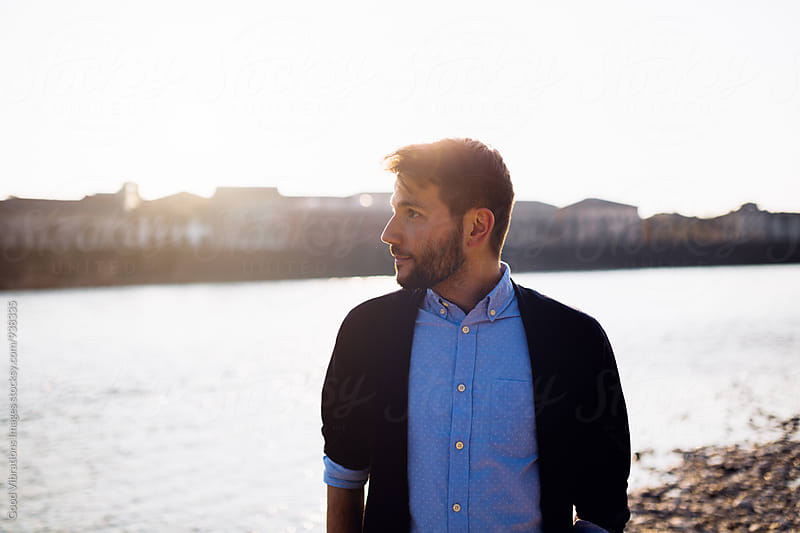 Portrait of a man at sunset by the river by Good Vibrations Images for Stocksy United