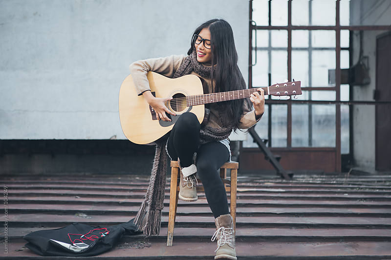 Asian Woman Playing the Guitar by Lumina for Stocksy United