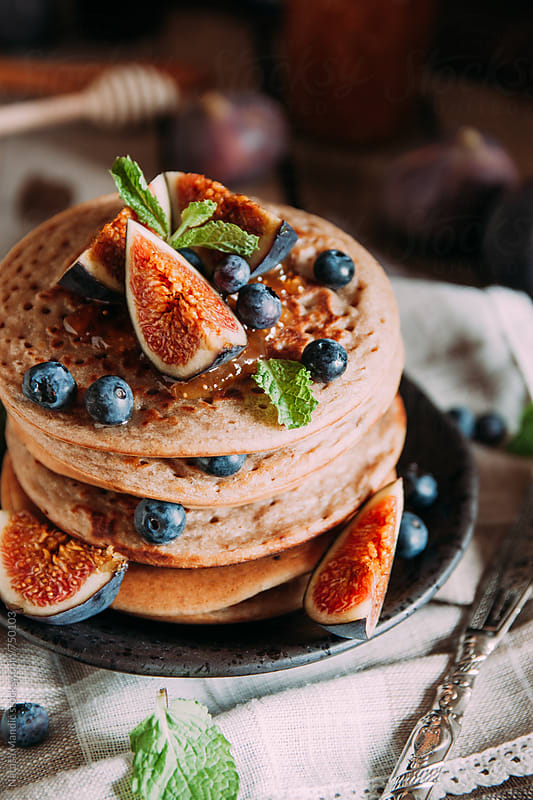 Delicious breakfast. Homemade pancakes with fresh figs and bluberries by Nataša Mandić for Stocksy United