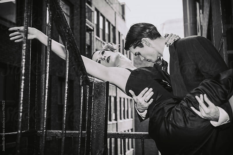 Hispanic Couple Dancing Tango in New York Fire Escape Stairs in Black and White by Joselito Briones for Stocksy United