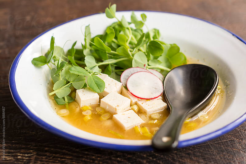 Tofu Soup with Pea Shoots and Radish by Harald Walker for Stocksy United