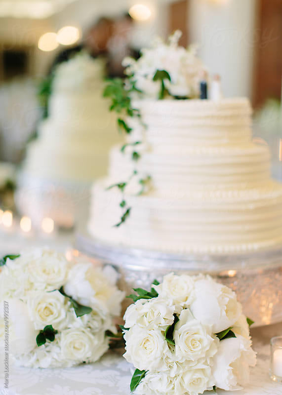 Bouquets and Wedding Cake by Marta Locklear for Stocksy United