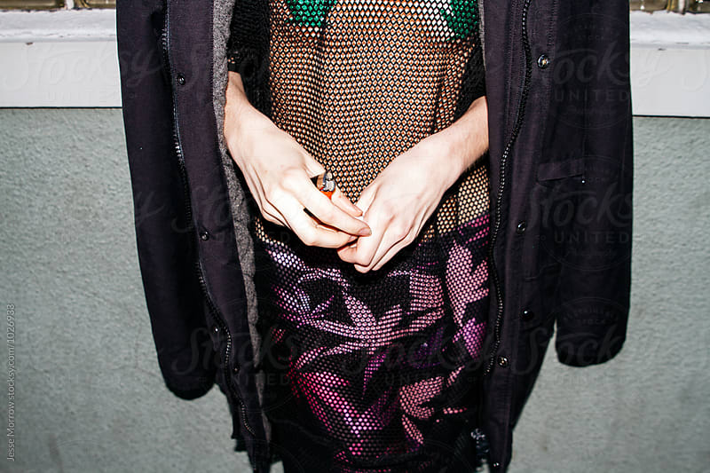 women with marijuana leaf leggings and spiky boots by Jesse Morrow for Stocksy United