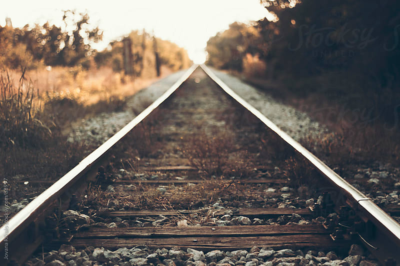 Railway in sunset by Jovana Rikalo for Stocksy United