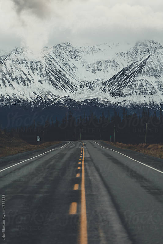 Dark and Gloomy Yukon Road by Jake Elko for Stocksy United