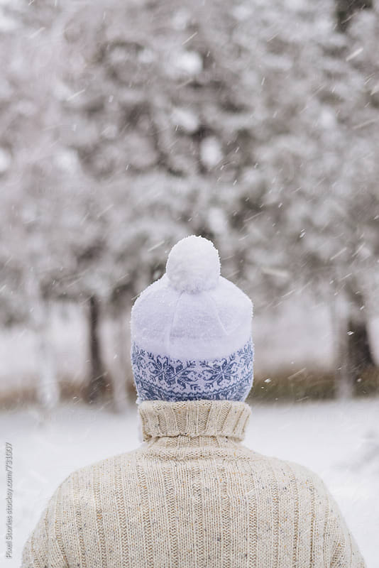 Woman with snowy pom-pom hat  by Pixel Stories for Stocksy United