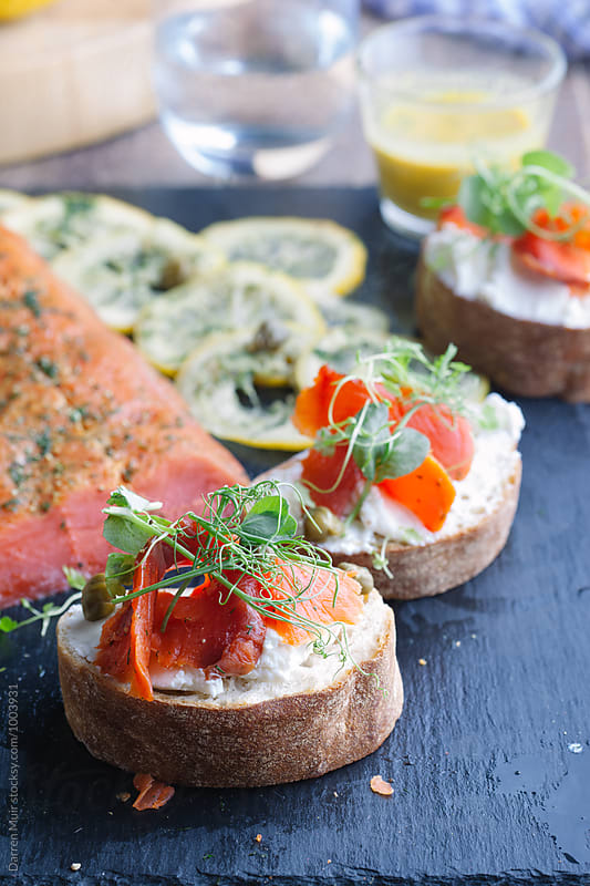 Gravlax and cream cheese appetizers. by Darren Muir for Stocksy United