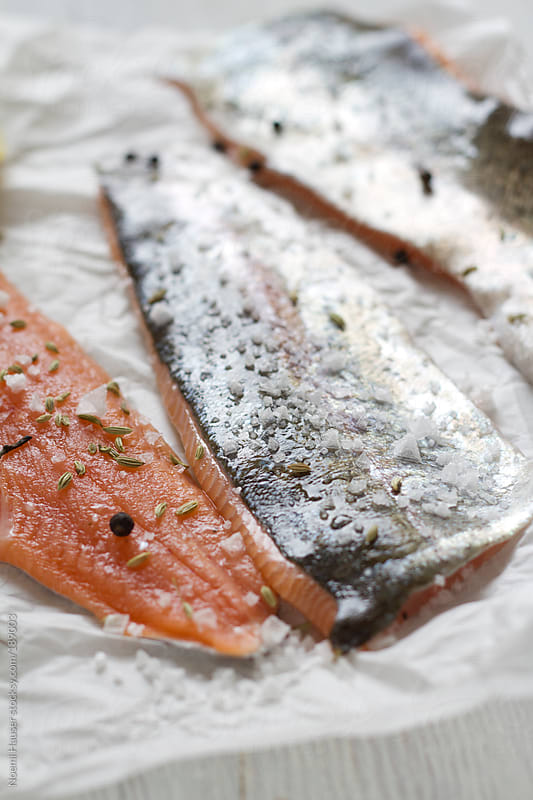 Salmon trout fillets by Noemi Hauser for Stocksy United