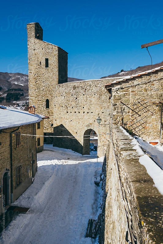 a typical italian village in winter by Juri Pozzi for Stocksy United