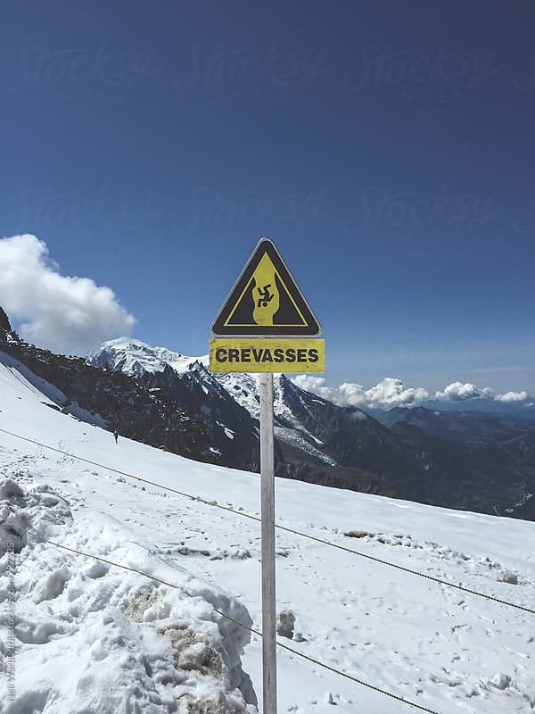 Crevasse warning sign by Neil Warburton for Stocksy United