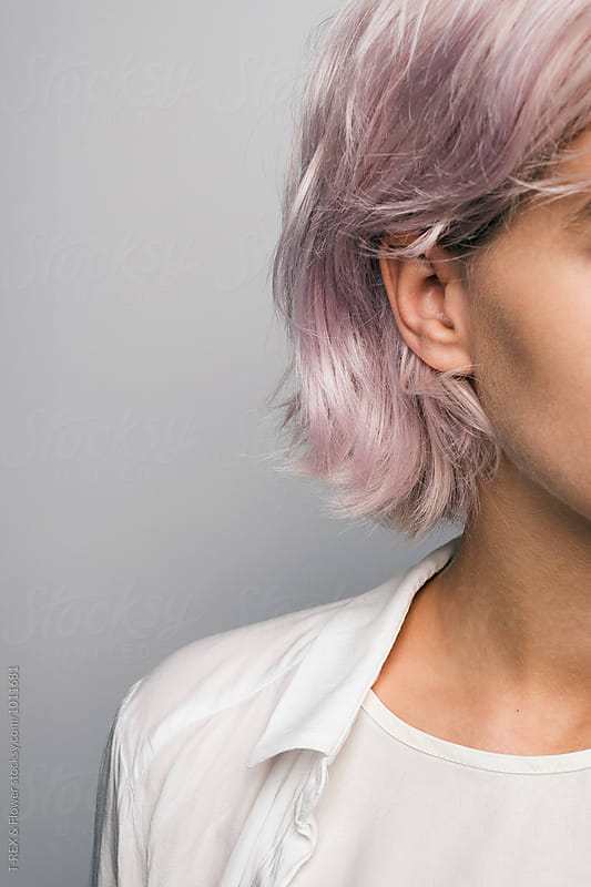 Close-up of pink-haired girl against of white background by Danil Nevsky for Stocksy United