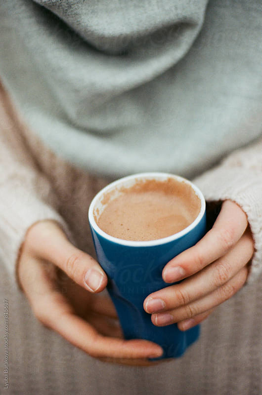 Woman holding cup of hot chocolate by Liubov Burakova for Stocksy United