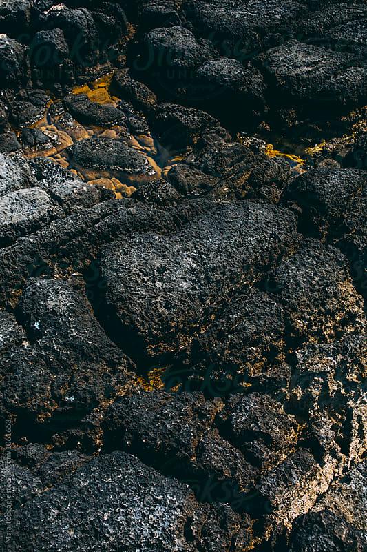 Black rock beach by Maja Topcagic for Stocksy United