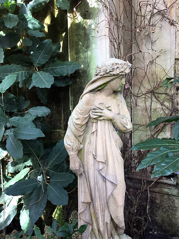 Statue standing in an old Orangery from 1872.  by Paul Phillips for Stocksy United