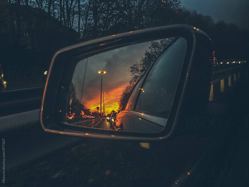 Sunset Reflected in a Rearview Mirror  by Mosuno for Stocksy United