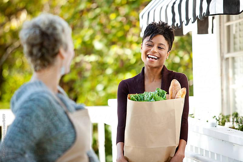Shop: Customer Carries Bag of Groceries by Sean Locke for Stocksy United
