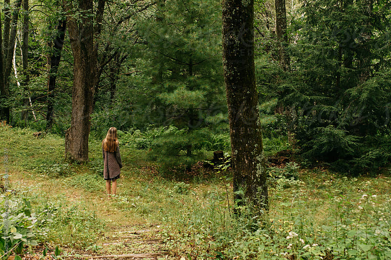 Woman on a nature walk in the forest by Gabriel (Gabi) Bucataru for Stocksy United