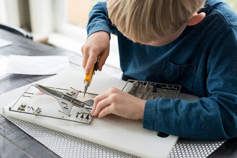 Little Boy Building Model Airplane Educational Hobby by JP Danko for Stocksy United