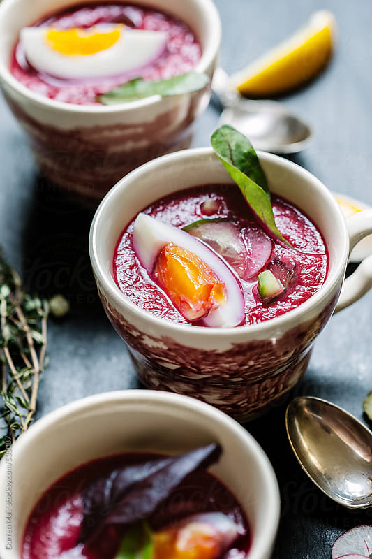 Chilled beet soup served in ornate cups. by Darren Muir for Stocksy United