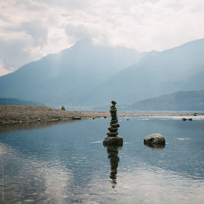 Cairn of stones on the river by GIC for Stocksy United