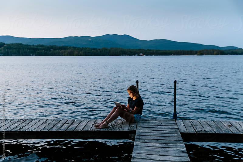 Teen Girl Using Tablet Lakeside by Raymond Forbes LLC for Stocksy United
