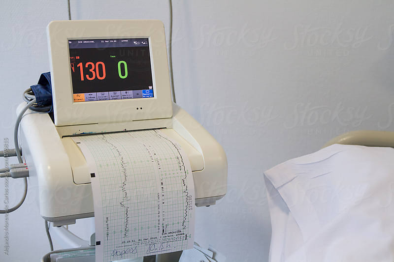 Medical equipment measuring vital signs at hospital by Alejandro Moreno de Carlos for Stocksy United