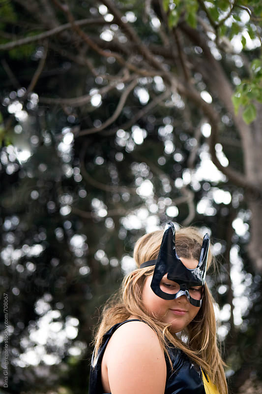 Pre-Teen Wearing a Super Hero Mask by Dina Giangregorio for Stocksy United