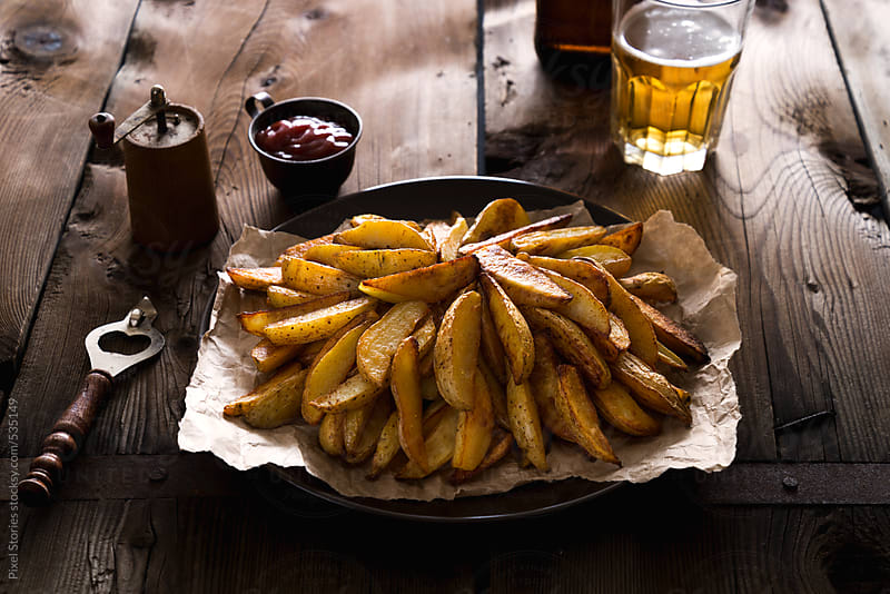 Food: oven fried potatoes by Pixel Stories for Stocksy United