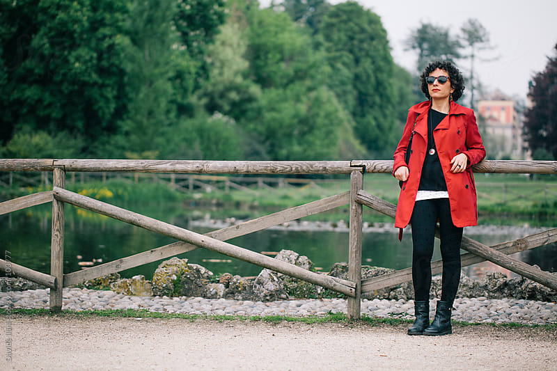 Young woman in the park in Milan by Davide Illini for Stocksy United