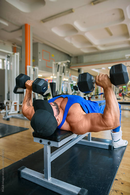 Bodybuilder working out chest muscles at the gym by RG&B Images for Stocksy United