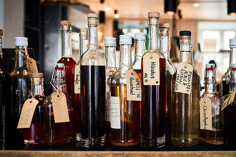 Bottles of different bitters and liqueurs by Trent Lanz for Stocksy United