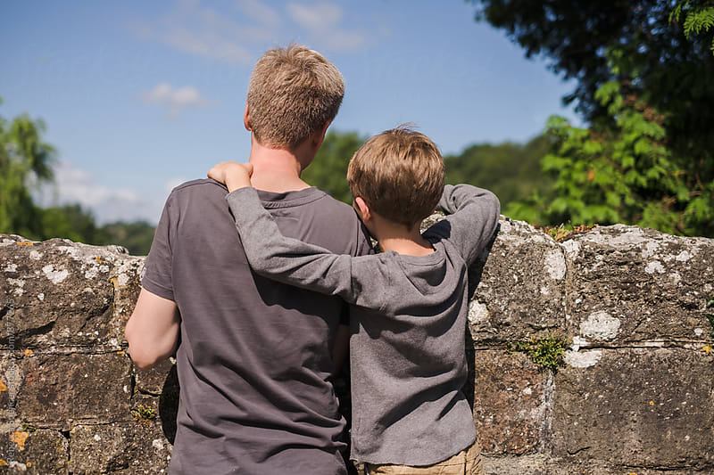 Sweet moment between father and son by Rebecca Spencer for Stocksy United
