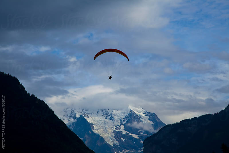 Paragliding in Interlaken, Switzerland by VICTOR TORRES for Stocksy United
