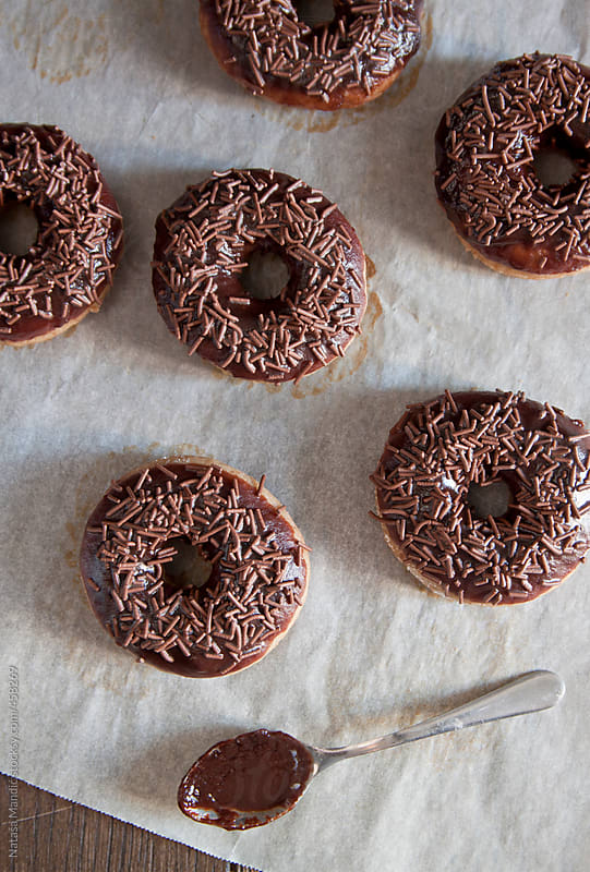 Homemade baked donuts with chocolate by Nataša Mandić for Stocksy United