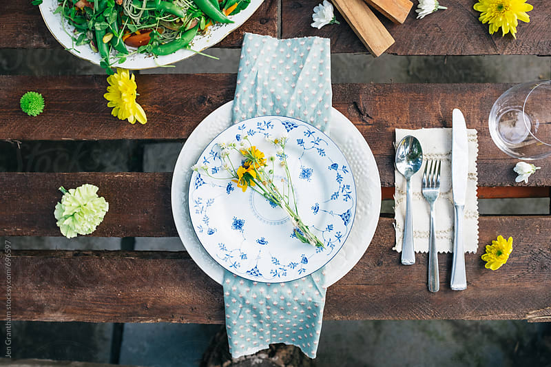 Summer dinner table place setting by Jen Grantham for Stocksy United