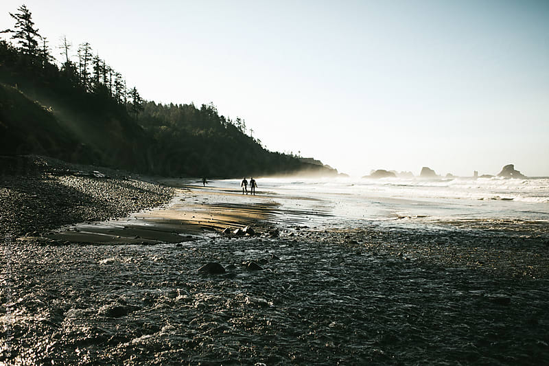 Surfers Walking the Oregon Coast by Kristine Weilert for Stocksy United