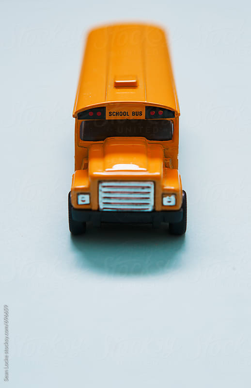 School Bus Metal Toy Vehicle by Sean Locke for Stocksy United