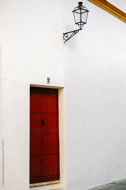 Numbered doorway outside Spanish building by Matthew Spaulding for Stocksy United