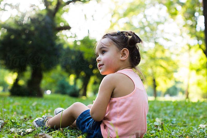 Child Sitting in the Grass by Mosuno for Stocksy United