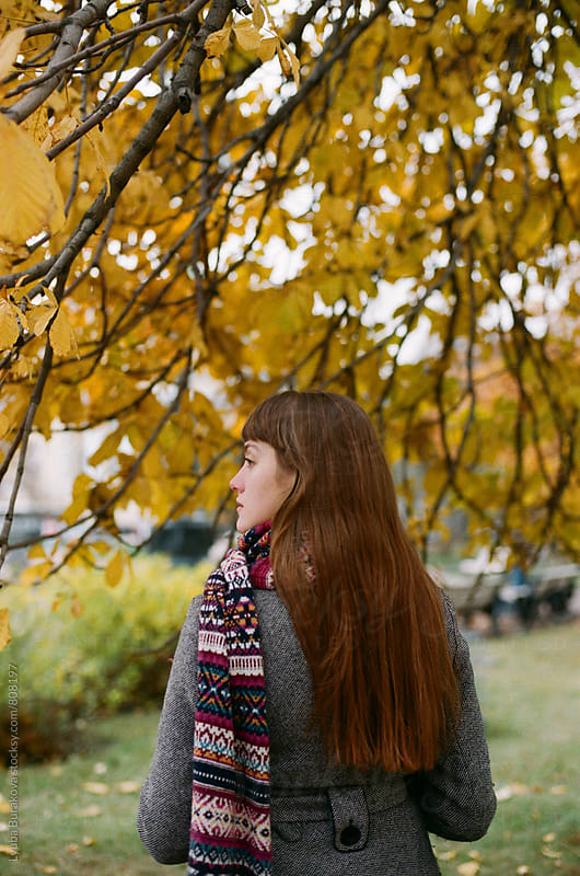 Autumn portrait of a young woman by Liubov Burakova for Stocksy United