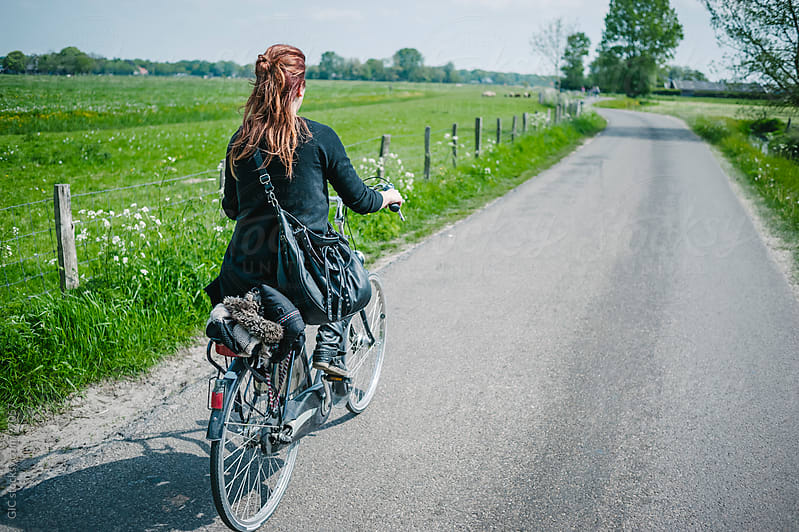 Girl rides a bicycle in the green country by GIC for Stocksy United