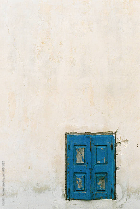 Window in Santorini by Kirstin Mckee for Stocksy United