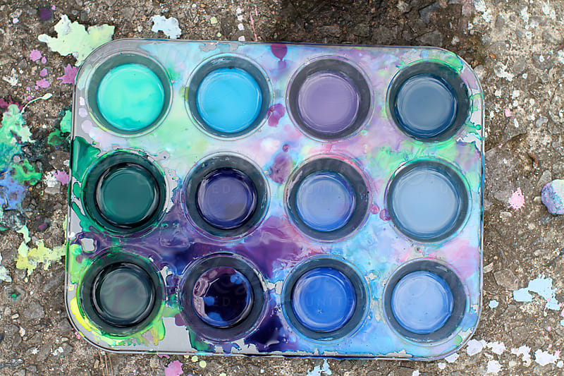 tray of paints on pavement by Jess Lewis for Stocksy United