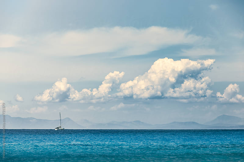 Sailboat Against the Sea and Sky by Helen Sotiriadis for Stocksy United