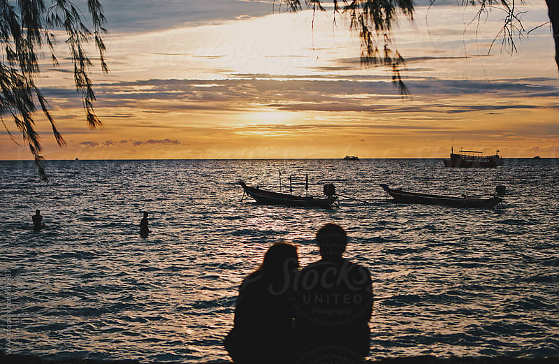Couple Watching Sunset by WAA for Stocksy United