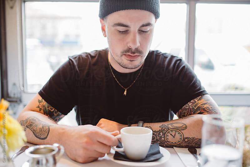 Portrait of young man in urban restaurant by Carey Shaw for Stocksy United