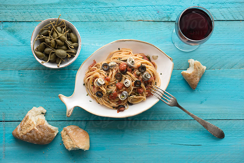 Food: Spaghetti Puttanesca by Ina Peters for Stocksy United