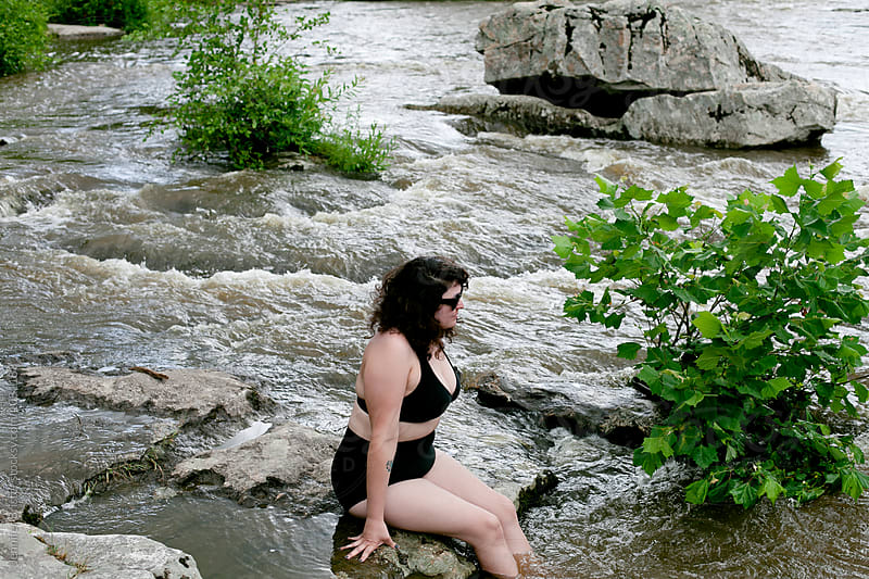 Woman in bikini in river  by Jennifer Brister for Stocksy United