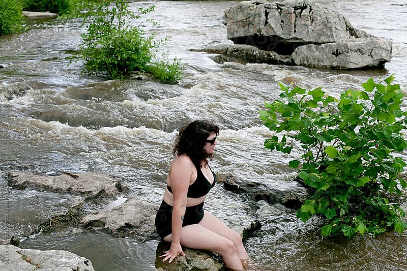 Woman in bikini in river  by Jennifer Brister for Stocksy United